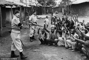 British police to guard suspected Mau Mau in Kariobangi Kenya in 1953