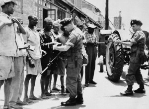 Men of the Royal Inniskilling Fusiliers verifies the identity of Africans during a raid in Nairobi in 1952
